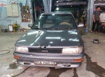 Bán Toyota Corolla sản xuất năm 1990, màu xám, nhập khẩu nguyên chiếc giá cạnh tranh giá 63 triệu tại Bình Dương