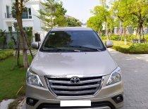 Tôi cần bán xe Toyota Innova 2.0E năm 2015, màu ghi vàng giá 425 triệu tại Hà Nội