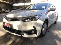 Bán xe Altis 1.8E số tự động sx 2018 màu trắng chạy 7.800 km giá 700 triệu tại Tp.HCM