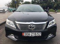 Cần bán gấp Toyota Camry 2.0E năm 2014, màu đen, 670tr giá 670 triệu tại Hà Nội