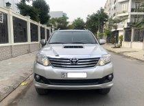 Cần bán gấp Toyota Fortuner 2.5 G, sx 2014 DK 2015, màu bạc giá 695 triệu tại Tp.HCM