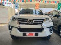 Cần bán xe Toyota Fortuner 2.7AT 4x2 đời 2016, màu trắng, nhập khẩu nguyên chiếc, số tự động giá 930 triệu tại Tp.HCM