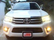 Cần bán Toyota Hilux 2.8G 4x4 AT đời 2016, màu trắng, nhập khẩu chính hãng  giá 710 triệu tại Tp.HCM