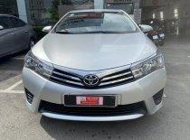Bán ô tô Toyota Corolla Altis 1.8G đời 2015, màu bạc giá thương lượng giá 590 triệu tại Tp.HCM