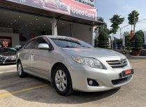 Cần bán xe Toyota Corolla Altis 1.8G đời 2010, màu bạc giá 430 triệu tại Tp.HCM