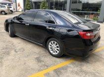 Bán Toyota Camry 2.0E đời 2013, màu đen, giá thương lượng giá 670 triệu tại Tp.HCM