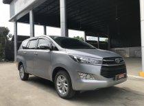 Cần bán xe Toyota Innova 2.0E đời 2017, màu bạc, giá tốt giá 610 triệu tại Tp.HCM