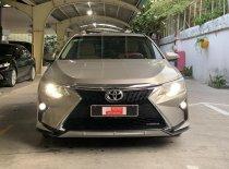 Bán Toyota Camry 2.0E đời 2015, màu nâu, giá tốt giá 770 triệu tại Tp.HCM
