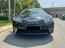 Cần bán xe Toyota Altis 1.8G CVT 2017 màu đen, xe đẹp đi kĩ giá 650 triệu tại Tp.HCM
