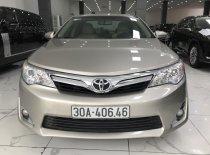 Cần bán Toyota Camry XLE đời 2013, màu vàng, nhập khẩu chính hãng, như mới giá 885 triệu tại Hà Nội